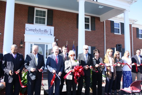 Senator Mitch McConnell joined the board members and other guests at the dedication ceremony in cutting the ribbon of the new Conover Education Center.
