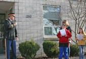 Kendra Peek/kendra.peek@amnews.com Junction City students Charlie Edwards and Kesley Rector, with principal Pam Strunk, while Major Jimmie Warinner speaks to the school.