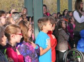 Kendra Peek/kendra.peek@amnews.com AJ Shell, center, and his classmates say the pledge during the morning Veteran's Day event at Junction City Elementary School.