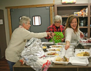 Kendra Peek/kendra.peek@amnews.com Ann Nicols, Carla Baker, and Djuana Reed prepare food trays to be delivered to dispatchers, emergency room workers and jail employees during the first responder thank you dinner, help by the Boyle County Agency for Substance Abuse Policy.