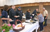 Kendra Peek/kendra.peek@amnews.com Alane Mills and Brent Blevins served food to EMT student Jimmy Carlton, left, Paramedic Justin Kendrick, EMT Daniel Pilcher, Paramedic Kay Roberts, and Capt. Jon Wesley with Boyle County EMS at the dinner to benefit emergency responders Tuesday night.
