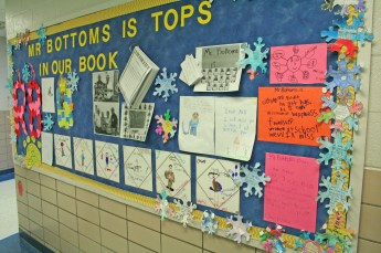 Kendra Peek/kendra.peek@amnews.com A bulletin board at the school celebrated Ronnie Bottoms, beloved custodian at Perryville Elementary School. Bottoms retires on Wednesday after 21 years at the school.