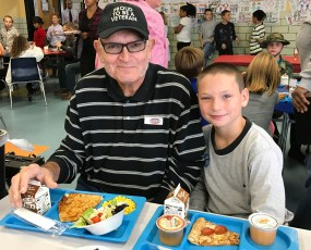 Photo submitted Jennie Rogers student Colton Kelly with his grandfather Ed Kelly during the school's Veteran's Day lunch.