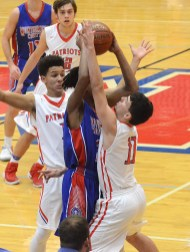 MONTGOMERY COUNTY'S Myron Ralls gets smothered by Lincoln County defenders Chase Phillips (11) and Devin Alcorn during second-half action in the Clash of Titans Tournament. Photo by Nancy Leedy