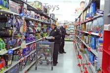 Kendra Peek/kendra.peek@amnews.com Lt. Timothy Blakemore, left, and Lt. Patrick Denham, right, shop for the Danville Fire Department Toy Drive.