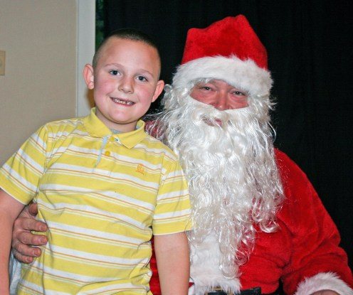 Kendra Peek/kendra.peek@amnews.com Kagen Coffey with Santa, Bruce Coffey.