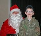 Kendra Peek/kendra.peek@amnews.com Tyler Dale Gammon with Santa, Bruce Coffman.