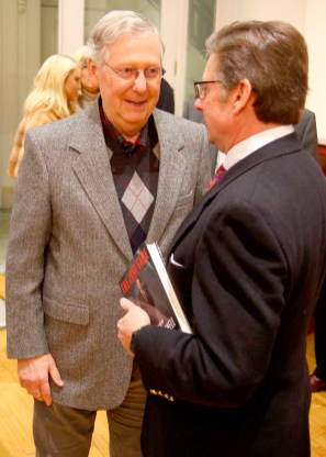 Ben Kleppinger/ben.kleppinger@amnews.com U.S. Sen. Mitch McConnell, left, speaks with Danville Mayor Mike Perros at Boyle County Republicans' Christmas party Tuesday night.