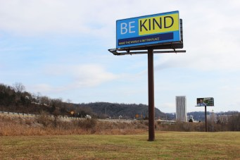 """Centre professor David Anderson places a """"Be Kind"""" billboard on Highway 127 in Frankfort to help remind people to be kind in the midst of the problems going on in the nation."""