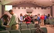 Kendra Peek/kendra.peek@amnews.com Before ending the Hope Network meeting, individuals gathered in groups to pray.