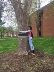 Photo submitted Danville High School Zyi Ixzin hugs a newly-wrapped tree at the school on Wednesday.