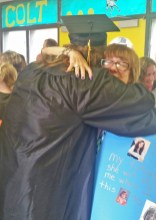Kendra Peek/kendra.peek@amnews.com Jamie Bright, instructional assistant at Woodlawn Elementary School, hugs Chandler Lane, a graduating Boyle County senior, on Friday after the Rebel Walk. The senior class walked the halls of each of the elementary schools in their caps and gowns, to the cheers of students and teachers.