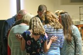 Kendra Peek/kendra.peek@amnews.com Staff from the Danville Christian Academy pray over Madison Elizabeth Carnes during the 2017 DCA graduation