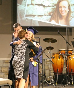 Kendra Peek/kendra.peek@amnews.com Jenny Beth Cox hugs Headmaster Debbie Lucas after accepting her diploma from Board Chairman Fred Sizemore at the Danville Christian Academy graduation on Saturday.