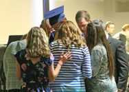 Kendra Peek/kendra.peek@amnews.com Staff members of the Danville Christian Academy pray over graduate Daryn Jonathan Starr after he received his diploma on Saturday. As each graduate departed the stage with their diploma, staff would gather around them to pray for their future path.