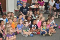 A group of children are excited to see the Animal Tales presentation at the library.
