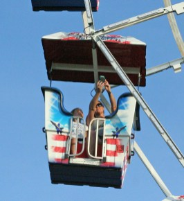 Kendra Peek/kendra.peek@amnews.com Grace, left, and Stephanie Conn, right, take a selfie on the ferris wheel.