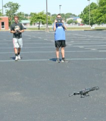 Kendra Peek/kendra.peek@amnews.com Lathan Moore, left, and Michael Farthing, right, in a drone diversion class at Black and Gold Academy. Moore was operating the drone while Farthing observed it's camera.
