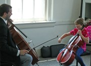 Kendra Peek/kendra.peek@amnews.com Luke Darville, left, and Anika Ellis, 9, right, at Darville String studio.