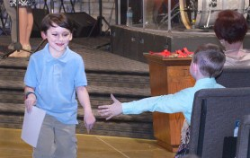 Benton Brown reaches out to his friend, Caleb Carter, after he received a certificate.