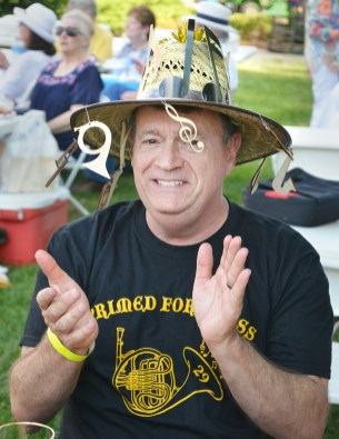 David Roberts claps with the rhythm of a band as he awaits the judging of the picnic table entries at the GABBF Great American Picnic.