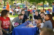 A table of friends enjoy each other's company at the GABBF picnic.