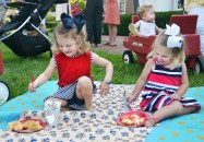 At left, Emily Elizabeth Thornberry and Ann Margaret Ahnquist eat their dinner on a blanket at the GABBF picnic Saturday night.