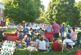 Many festival-goers enjoy their picnic in the shade on the hill above the main concert stage.