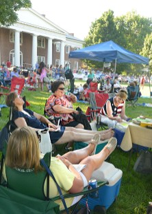 Susan Shirar, foreground, stretches out comfortably under a tree at at the GABBF picnic with her friends from Corbin, from left, Teresa Vorhees, Shelley Knust and Barbara Darabant.