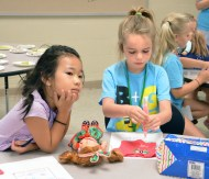 During the American Girl Fashion class, Joanna Ty, left and Zoe Zimmerman, embellish a T-shirt for their American Girl Doll. The class helps young students design clothing and accessories for their dolls.