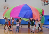 Photos by Robin Hart robin.hart@amnews.com Students in a PE class work together to inflate a parachute.
