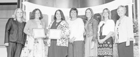 Teachers honored for the Garrard County School System were, second from left: Heather Shepherd and Laura Hoskins. Also attending were, fourth from left: Tracie Bottoms, principal of Lancaster Elementary School; Diana Hart, principal of Garrard County High School, and Laura Perry, district instructional coordinator. Presenting the awards were Dr. Donna Hedgepath, far left, provost and vice president for academic affairs, and Dr. Beverly Ennis, far right, dean of the School of Education.