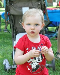 Kendra Peek/kendra.peek@amnews.com Lily, 20 months, picks out fabric at the Creation Station during the Great American Brass Band Festival.