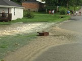 Photo courtesy of Boyle County Emergency Management Junction City Residents observe flooding Sunday.