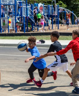 Ben Kleppinger/ben.kleppinger@amnews.com Kyren Burdette, left, dribbles while guarded by Jacob Singleton during recess Thursday. Students were playing on the new basketball courts next to the school's new playground.