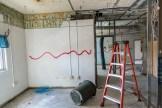 Ben Kleppinger/ben.kleppinger@amnews.com Walls scheduled for demolition inside the school are marked with red lines.
