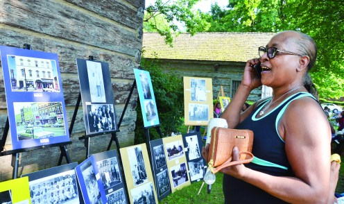 Adrienne Letcher, of Danville, talks to someone about the photo display she looking at during the Soul of Second Street Festival Saturday at Constitution Square Park.