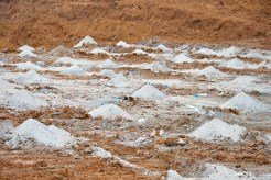 Dozens of holes 20 feet deep are filled in with explosives and rock at an area to soon be detonated at the construction site of the new Boyle County Middle School.