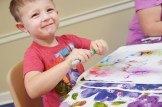 Will Sledge, 3, who came to Kinsey's tie-dyed backpacks program with his grandmother Carol Vance, loved drawing on the backpack with markers. Kinsey leads up the programs several times a week and says it's good for kids to relate having fun and creativity with the library.