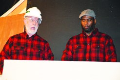 Fred and Marty (Mike Crocetti, left, and Mark Porter) don matching red plaid shirts as they embark on a bizarre woodworking project together.