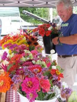 Photo by Susan Jonas You can track the seasons at the Boyle County Farmers Market by watching the selections of flowers grown by Russ Goodwin and his wife Margo. The snapdragons, iris, and sweet peas of early spring have given way to a colorful riot of zinnias, sunflowers, and dahlias, perfect for fall decorating.