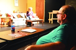 "Photos by Bobbie Curd/bcurd@amnews.com Director Steve Sleeper takes in a recent dress rehearsal for ""A Red Plaid Shirt"" at West T. Hill Community Theatre. He decided to direct the production because the script made him ""laugh out loud, several times, just from reading it. That's a rarity."""