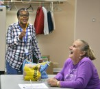 Robin Hart/robin.hart@amnews.comSharon Hernandez laughs as Delores Yocum teases her about having blue teeth after eating a blue cupcake.