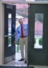 Photo by Robin Hart/robin.hart@amnews.com Ray Woodyad with the KCSS inspects an outside door near the band room at Danville High School.
