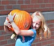 Robin Hart/robin.hart@amnews.com Bailey Bays is all smiles after choosing the perfect pumpkin.