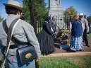 Dignitaries place a wreath at a Confederate monument at Perryville Battlefield during a memorial service.