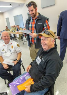 Ben Kleppinger/ben.kleppinger@amnews.com Matthew Aaron with the Division of Reentry Services, standing, checks on how well Gen. Howard Hunt, seated at right, did on his tasks during a week of the simulation. Hunt failed a test, but Aaron decided to give him diversion and not send him to jail.