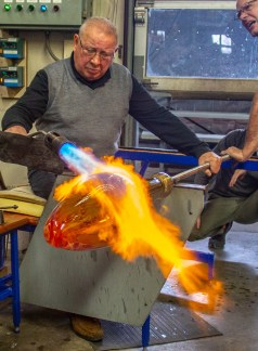 Ben Kleppinger/ben.kleppinger@amnews.com Tagliapietra uses a blowtorch to heat glass as he shapes it.