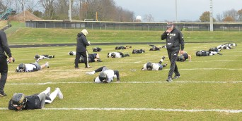 Boyle County High School football players do warm up and stretching exercises Monday as Coach Chuck Smith walks the lines.