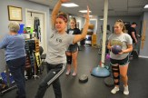Photos by Bobbie Curd/bobbie.curd@amnews.com Physical therapist Gina Motley, front, shows Danville soccer player Ella McKinney, left, and Jolie Gardner, a Boyle County soccer player, exercises in order to rehabilitate their ACL injuries.